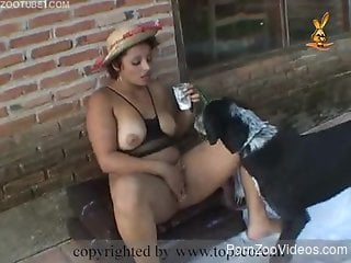 Busty slut loves the dog's dick in her shaved pussy
