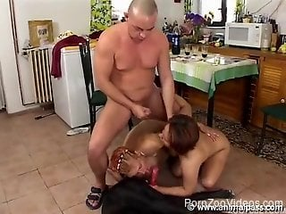 Zoophilia porn in the kitchen with a man and two sluts