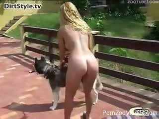 Sloppy zoophilia blowjob by a blonde hottie on a dog's dick