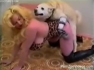 Blondie with incredibly massive boobs bangs with a white dog