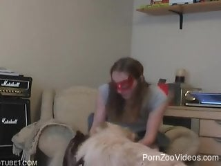 Masked cutie trains her dog in a dirty way