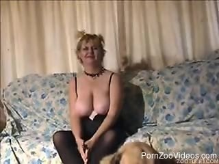 Big-boobed mature decided to please her doggy