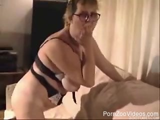 Mature slut with huge boobs bangs with a dog on the sofa