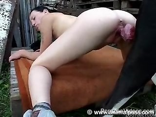 Slender brunette with small tits fucks outdoors with a dog