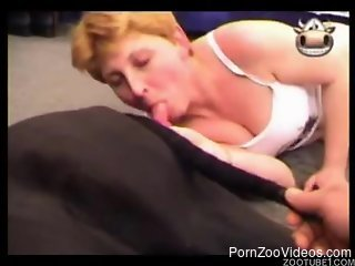 Short-haired redhead sucking a dog's big red cock