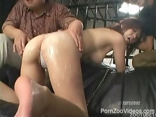 Big-bottomed Asian fuck doll bangs with black dog in public place