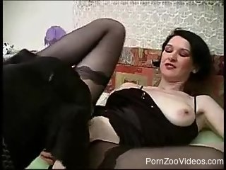 Mature brunette in stockings uses black dog for sexual purpose