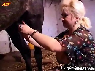 Busty blond-haired bitch blows a hung horse on cam