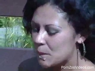 Brunette babe eats dog cum and sucks dog cock