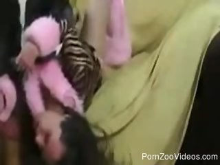 Brunette getting throat-fucked by a well-endowed dog